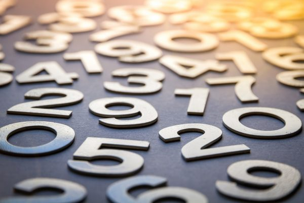 Mathematics abstract background made with solid numbers - Closeup view